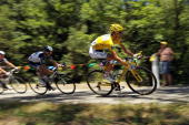 Andy Schleck wears the yellow jersey on Stage 14 of the Tour de France the first stage to enter the Pyrenees on July 18 2010 in Ax 3 Domaines France...