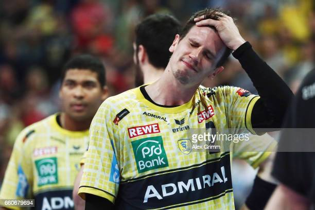 Andy Schmid and team mates of RheinNeckar Loewen react after the EHF Champions League Quarter Final Leg 2 match between Rhein Neckar Loewen and THW...