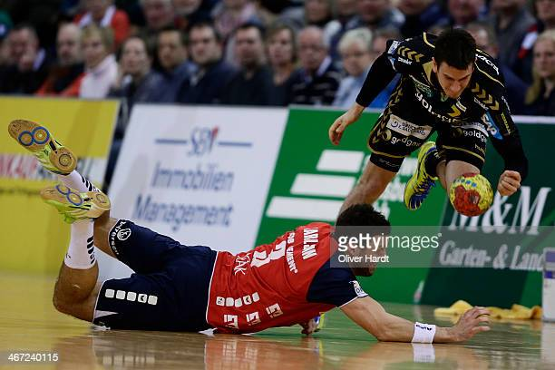 Andy Schmid of Rhein Neckar challenges for the ball with Tobias Karlsson of Flensburg during the Bundesliga handball match between Flensburg...