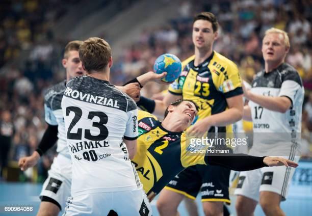 Andy Schmid of RheinNeckar Loewen is challenged by Rune Dahmke of Kiel during the DKB HBL match between RheinNeckar Loewen and THW Kiel at SAP Arena...