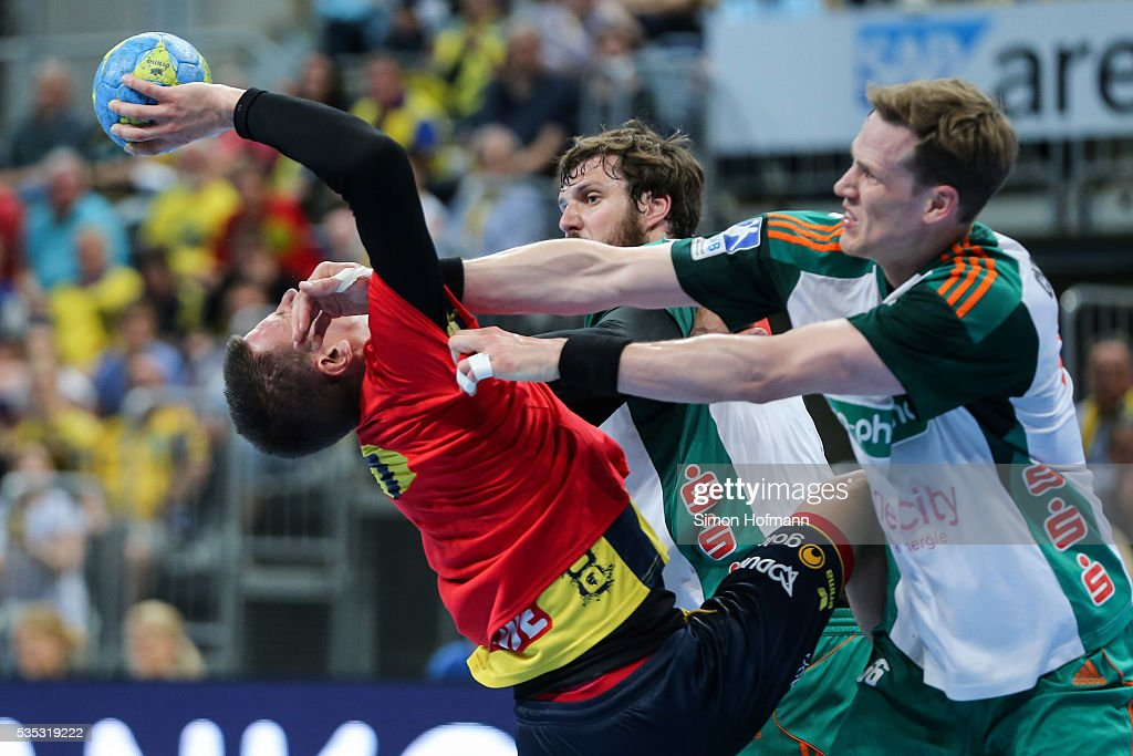 Andy Schmid of Rhein-Neckar Loewen is tackled by Sven-Soeren Christophersen of Hannover (front) during the DKB Handball Bundesliga match between Rhein-Neckar Loewen and TSV Hannover-Burgdorf at SAP Arena on May 29, 2016 in Mannheim, Germany.