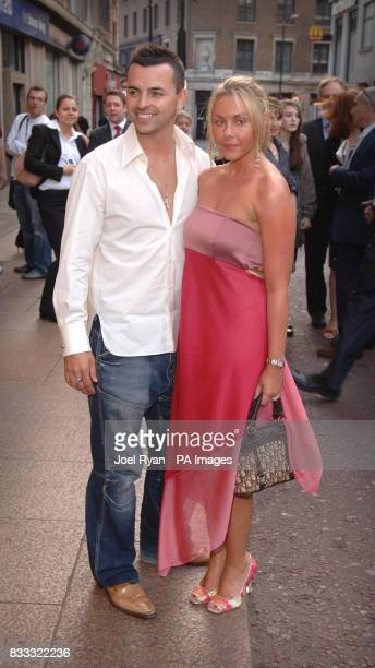 Andy Scott Lee and Michelle Heaton arrive for the gala Screening of Top Gun at the Odeon West End in central London