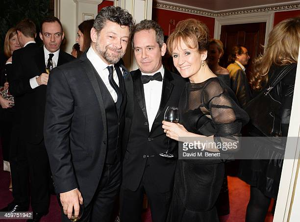 Andy Serkis Tom Hollander and Lorraine Ashbourne attend a champagne reception at the 60th London Evening Standard Theatre Awards at the London...