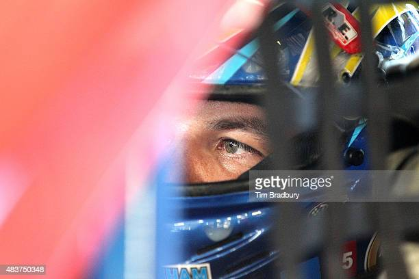 Andy Seuss driver of the Cape Cod Aggregates/JR PreCast Chevrolet sits in his car during practice for the NASCAR Whelen Modified Tour Budweiser King...