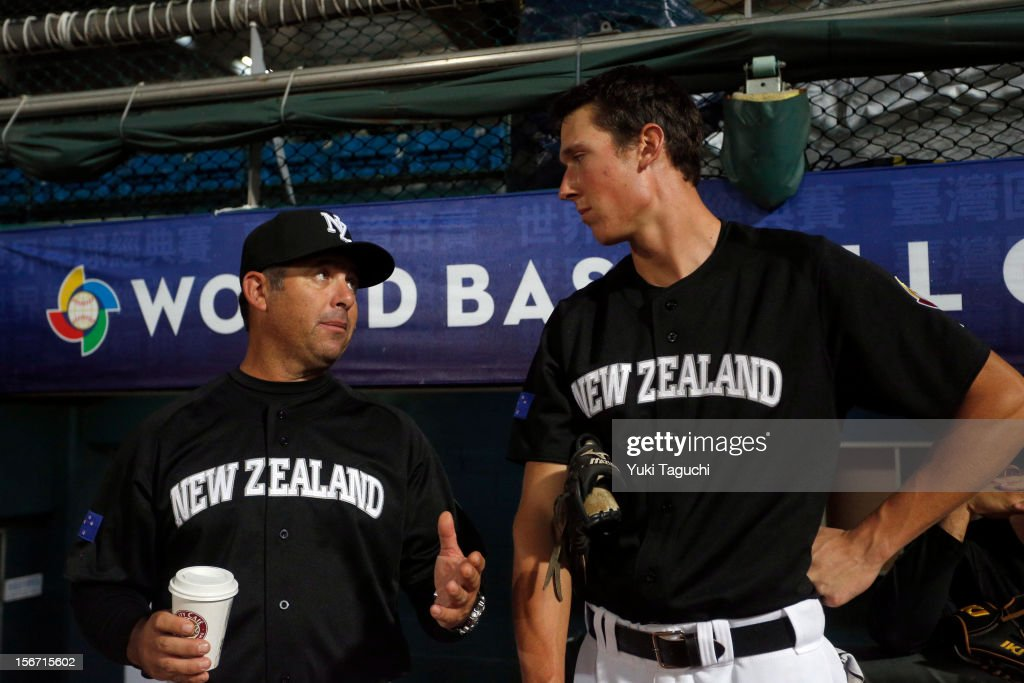 Andy Skeels manager of Team New Zealand talks with Max Brown #11 of Team New Zealand in the dugout before Game 5 of the 2013 World Baseball Classic Qualifier against Team Philippines at Xinzhuang Stadium in New Taipei City, Taiwan on Saturday, November 17, 2012.