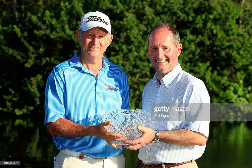 Andy Stubbs, Managing Director of the European Senior Tour presents <a gi-track='captionPersonalityLinkClicked' href=/galleries/search?phrase=Roger+Chapman&family=editorial&specificpeople=569611 ng-click='$event.stopPropagation()'>Roger Chapman</a> of England with the John Jacobs Trophy for winning the Order of Merit for 2012 after the final round of the MCB Tour Championship played at the Legends Course, Constance Belle Mare Plage on December 9, 2012 in Poste de Flacq, Mauritius.