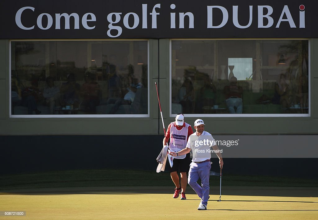 <a gi-track='captionPersonalityLinkClicked' href=/galleries/search?phrase=Andy+Sullivan+-+Golfer&family=editorial&specificpeople=13886721 ng-click='$event.stopPropagation()'>Andy Sullivan</a> of England acknowledges his birdie on the 16th hole during the third round of the Omega Dubai Desert Classic at the Emirates Golf Club on February 6, 2016 in Dubai, United Arab Emirates.