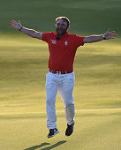 Andy Sullivan of England celebrates after his team win the the 'All Sports Challenge' on the Faldo Course ahead of the Omega Dubai Desert Classic at...