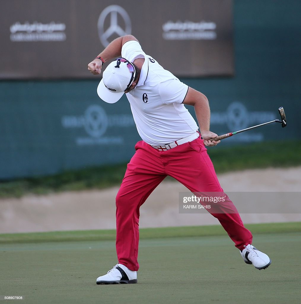 Andy Sullivan of England celebrates his birdie putt on the 18th green during the final round of the 2016 Dubai Desert Classic at the Emirates Golf Club in Dubai on February 7, 2016. SAHIB