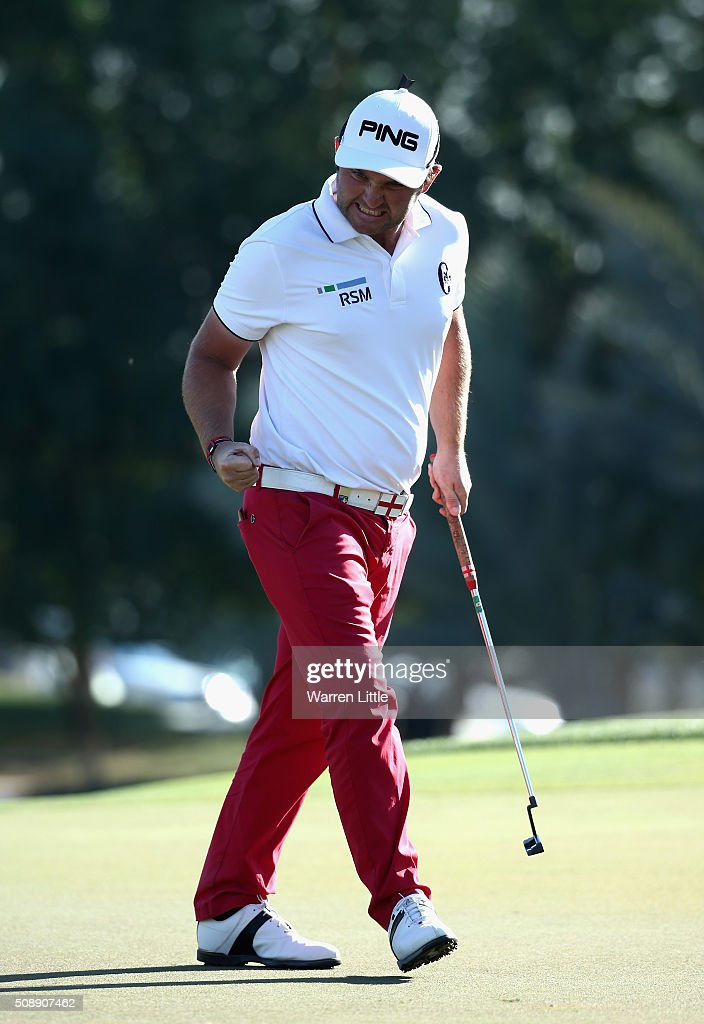 Andy Sullivan of England celebrates saving par on the 16th hole during the final round of the Omega Dubai Desert Classic on the Majlis Course at the Emirates Golf Club on February 7, 2016 in Dubai, United Arab Emirates.