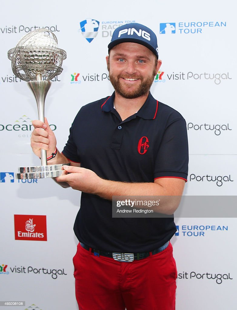 Andy Sullivan of England celebrates victory with the trophy after the Portugal Masters final round at Oceanico Victoria Golf Club on October 18 2015...