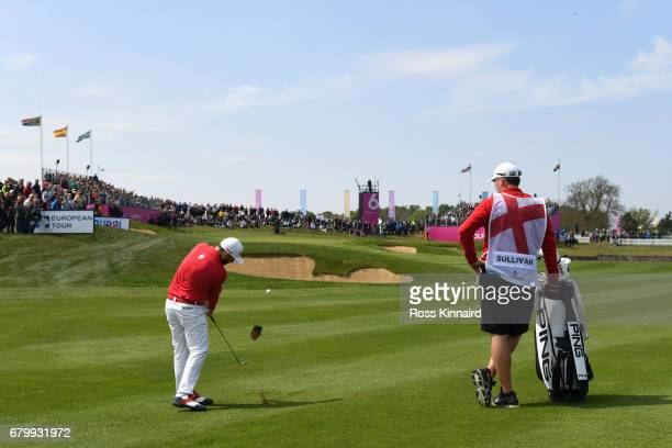 Andy Sullivan of England hits an approach to the 3rd green during the quarter final match between England and Italy during day two of GolfSixes at...