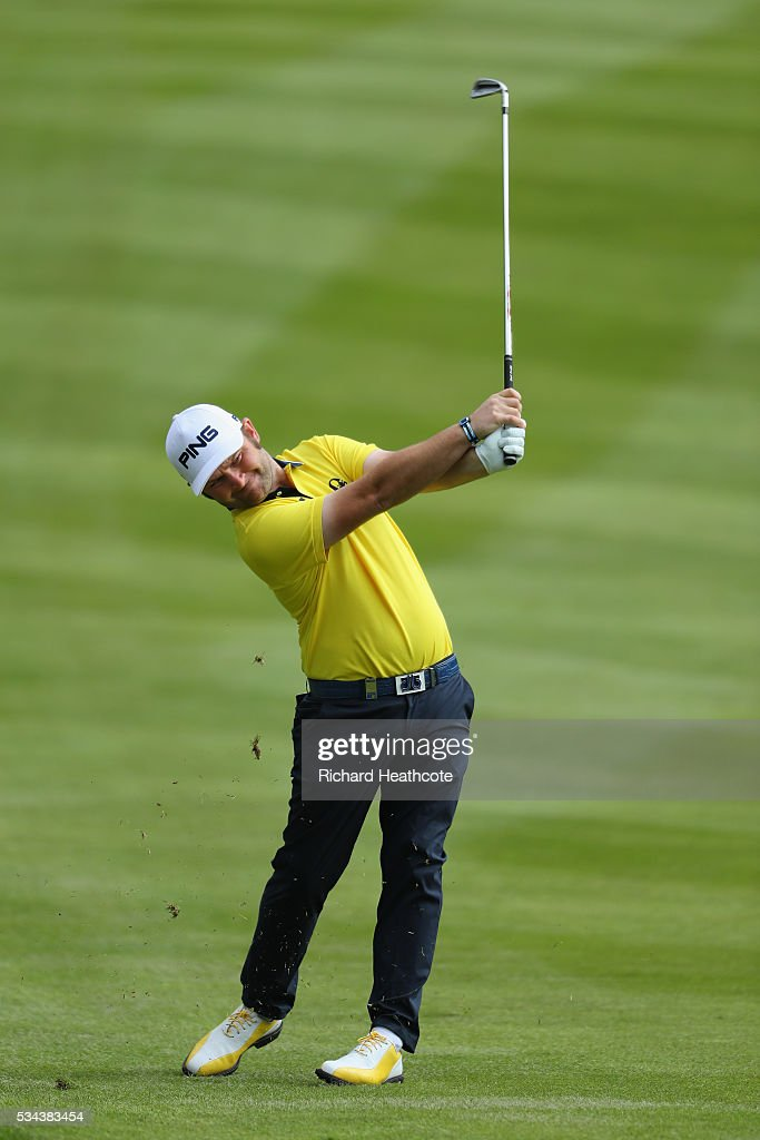 <a gi-track='captionPersonalityLinkClicked' href=/galleries/search?phrase=Andy+Sullivan+-+Golfer&family=editorial&specificpeople=13886721 ng-click='$event.stopPropagation()'>Andy Sullivan</a> of England hits his 2nd shot on the 4th hole during day one of the BMW PGA Championship at Wentworth on May 26, 2016 in Virginia Water, England.