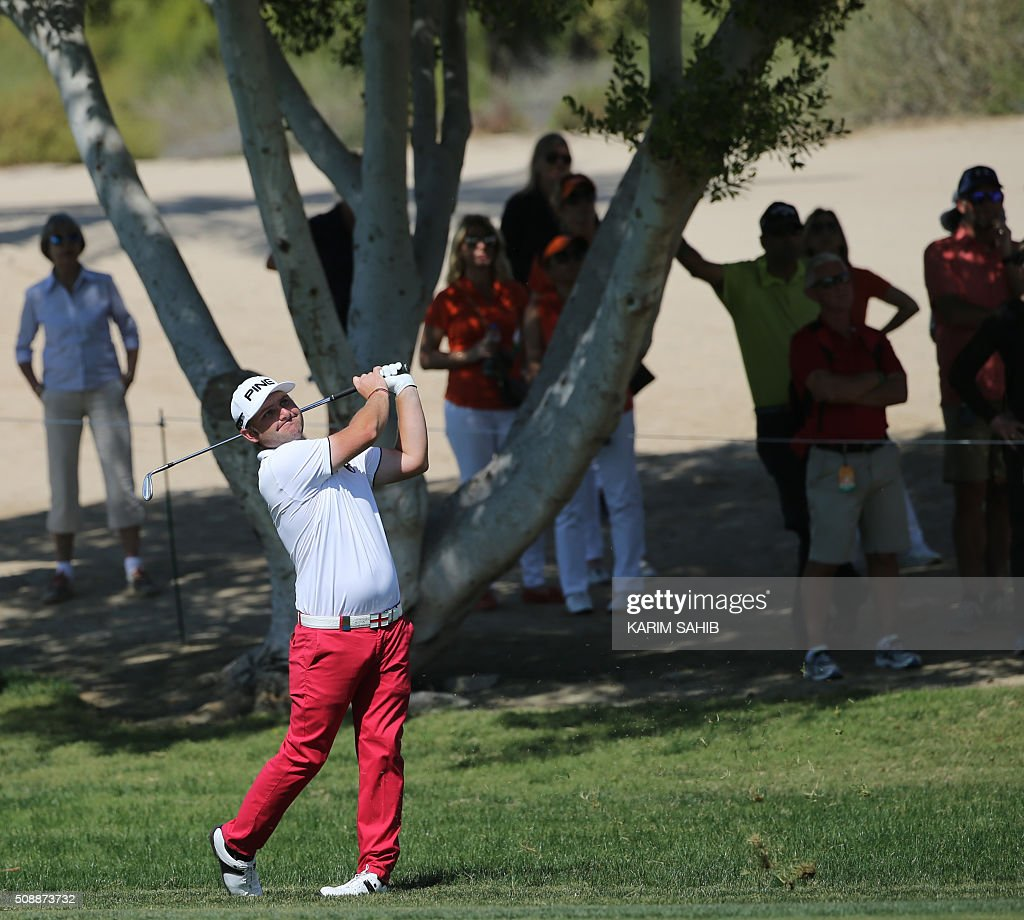Andy Sullivan of England plays a shot during the final round of the 2016 Dubai Desert Classic at the Emirates Golf Club in Dubai on February 7, 2016. SAHIB