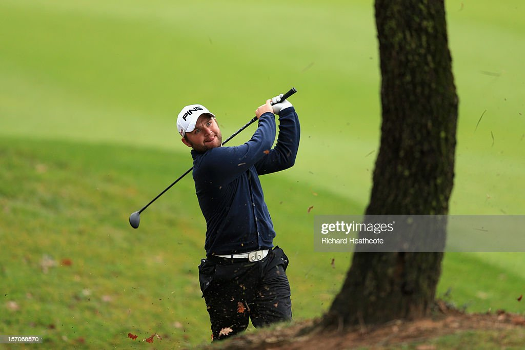 Andy Sullivan of England plays from around a tree on the 15th during the fifth round of the European Tour Qualifying School Finals at PGA Catalunya Resort on November 28, 2012 in Girona, Spain.