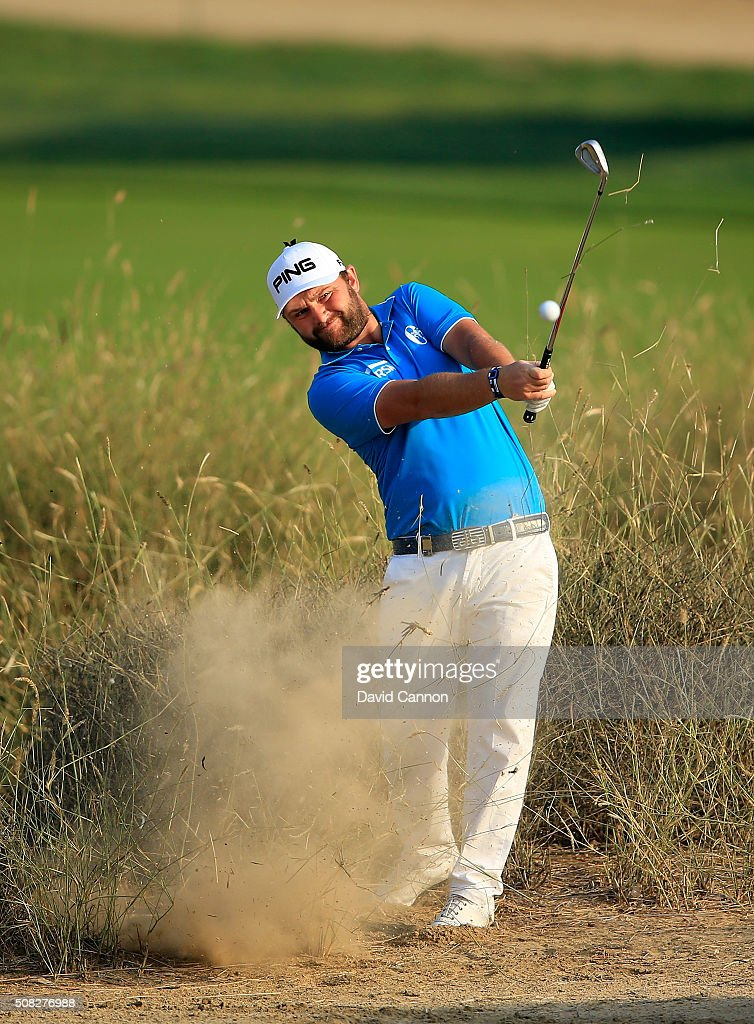 Andy Sullivan of England plays his fourth shot on the par 5 10th hole during the first round of the 2016 Omega Dubai Desert Classic on the Majlis...