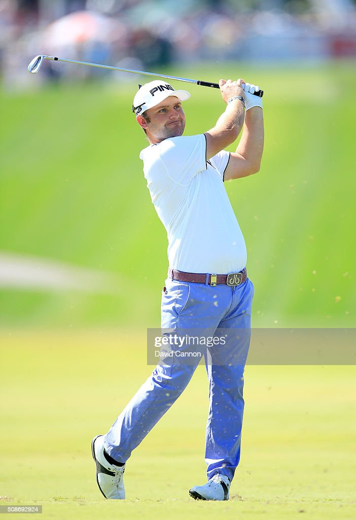 <a gi-track='captionPersonalityLinkClicked' href=/galleries/search?phrase=Andy+Sullivan+-+Golfer&family=editorial&specificpeople=13886721 ng-click='$event.stopPropagation()'>Andy Sullivan</a> of England plays his second shot at the par 4, first hole during the third round of the 2016 Omega Dubai Desert Classic on the Majlis Course at the Emirates Golf Club on February 6, 2016 in Dubai, United Arab Emirates.