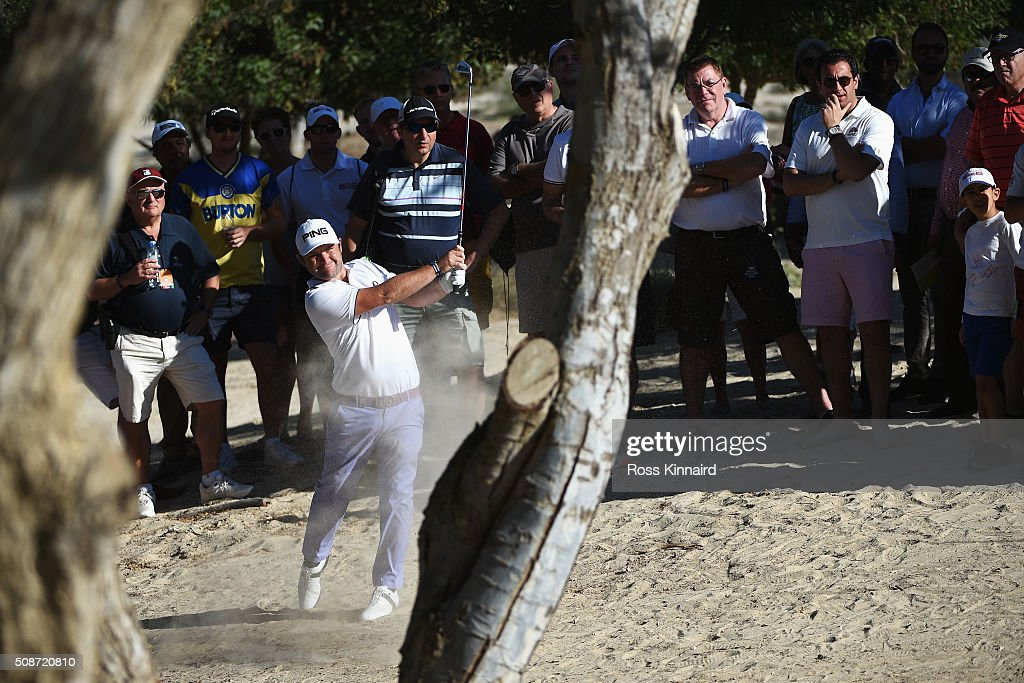 Andy Sullivan of England plays his second shot on the 16th hole during the third round of the Omega Dubai Desert Classic at the Emirates Golf Club on February 6, 2016 in Dubai, United Arab Emirates.