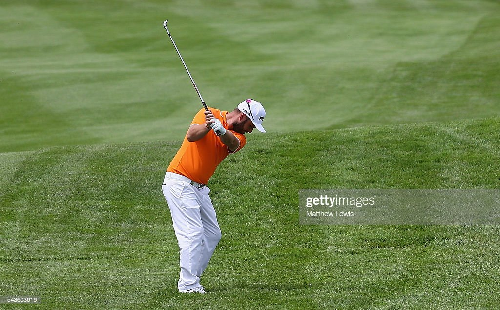 Andy Sullivan of England plays out of the rough during a pro-am round ahead of the 100th Open de France at Le Golf National on June 29, 2016 in Paris, France.
