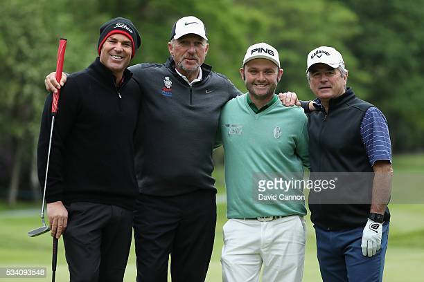 Andy Sullivan of England poses with former cricketers Shane Warne Sir Ian Botham and Allan Lamb during the ProAm prior to the BMW PGA Championship at...