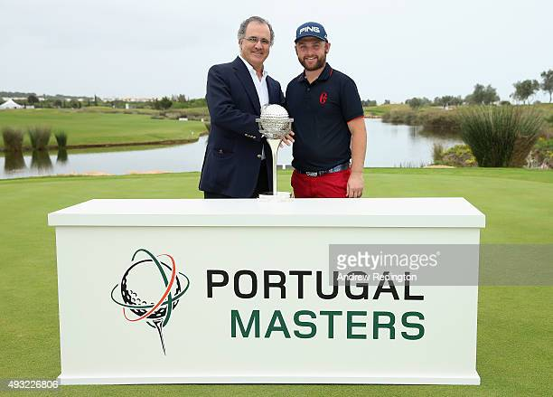 Andy Sullivan of England poses with the trophy alongside Antonio Pires De Lima Minister Of Economy after winning the Portugal Masters at Oceanico...