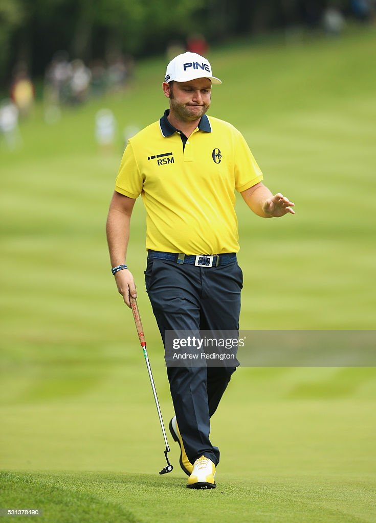 <a gi-track='captionPersonalityLinkClicked' href=/galleries/search?phrase=Andy+Sullivan+-+Golfer&family=editorial&specificpeople=13886721 ng-click='$event.stopPropagation()'>Andy Sullivan</a> of England reacts on the 4th hole during day one of the BMW PGA Championship at Wentworth on May 26, 2016 in Virginia Water, England.