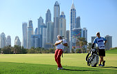 Andy Sullivan of England reacts to his second shot at the par 5 13th hole during the final round of the 2016 Omega Dubai Desert Classic on the Majlis...