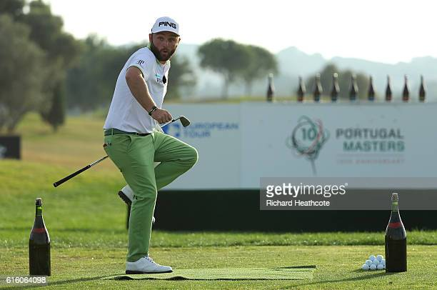 Andy Sullivan of England takes part in a bottle smashing stunt to celebrate the 10th edition of the Portugal Masters at the Victoria Clube de Golfe...