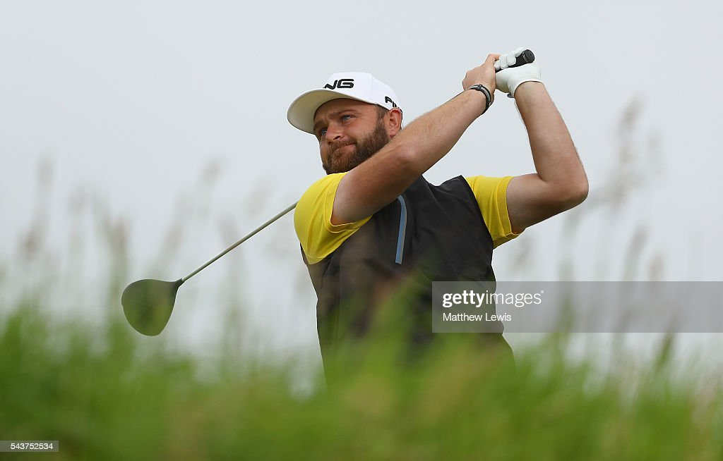 <a gi-track='captionPersonalityLinkClicked' href=/galleries/search?phrase=Andy+Sullivan+-+Golfer&family=editorial&specificpeople=13886721 ng-click='$event.stopPropagation()'>Andy Sullivan</a> of England tees off on the 12th hole during day one of the 100th Open de France at Le Golf National on June 30, 2016 in Paris, France.