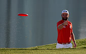 Andy Sullivan of England throws a frisby during the the 'All Sports Challenge' on the Faldo Course ahead of the Omega Dubai Desert Classic at...