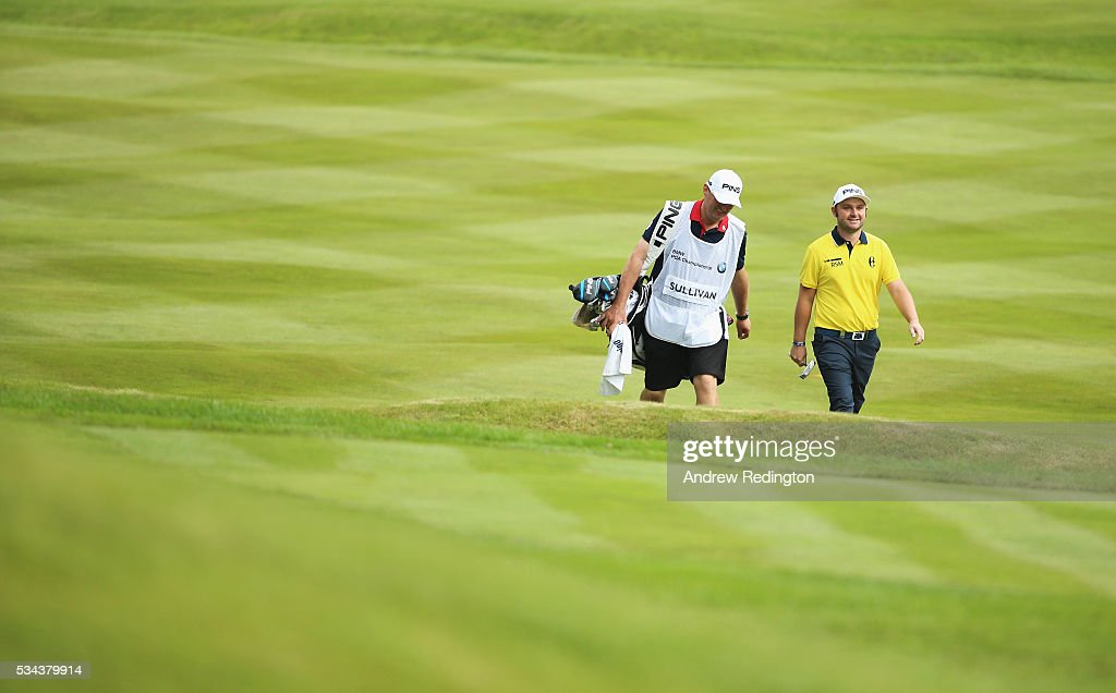 <a gi-track='captionPersonalityLinkClicked' href=/galleries/search?phrase=Andy+Sullivan+-+Golfer&family=editorial&specificpeople=13886721 ng-click='$event.stopPropagation()'>Andy Sullivan</a> of England walks down the 4th hole with his caddie during day one of the BMW PGA Championship at Wentworth on May 26, 2016 in Virginia Water, England.