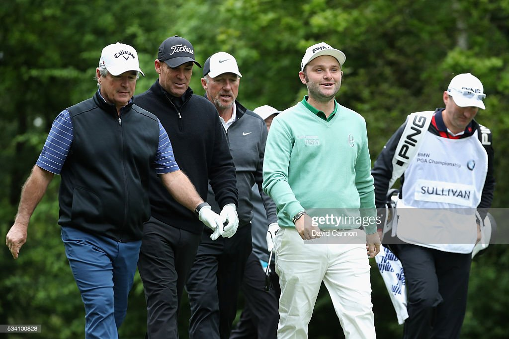 <a gi-track='captionPersonalityLinkClicked' href=/galleries/search?phrase=Andy+Sullivan+-+Golfer&family=editorial&specificpeople=13886721 ng-click='$event.stopPropagation()'>Andy Sullivan</a> of England walks with former cricketers Shane Warne, Sir <a gi-track='captionPersonalityLinkClicked' href=/galleries/search?phrase=Ian+Botham&family=editorial&specificpeople=207145 ng-click='$event.stopPropagation()'>Ian Botham</a> and Allan Lamb during the Pro-Am prior to the BMW PGA Championship at Wentworth on May 25, 2016 in Virginia Water, England.