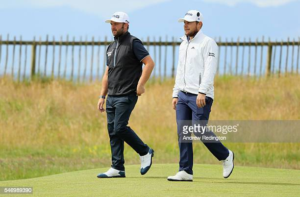 Andy Sullivan of England walks with Tyrrell Hatton of England on the 1st during a practice round ahead of the 145th Open Championship at Royal Troon...