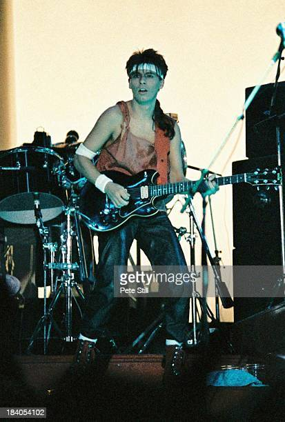 Andy Taylor of Duran Duran performs on stage at Wembley Arena on December 20th 1983 in London England