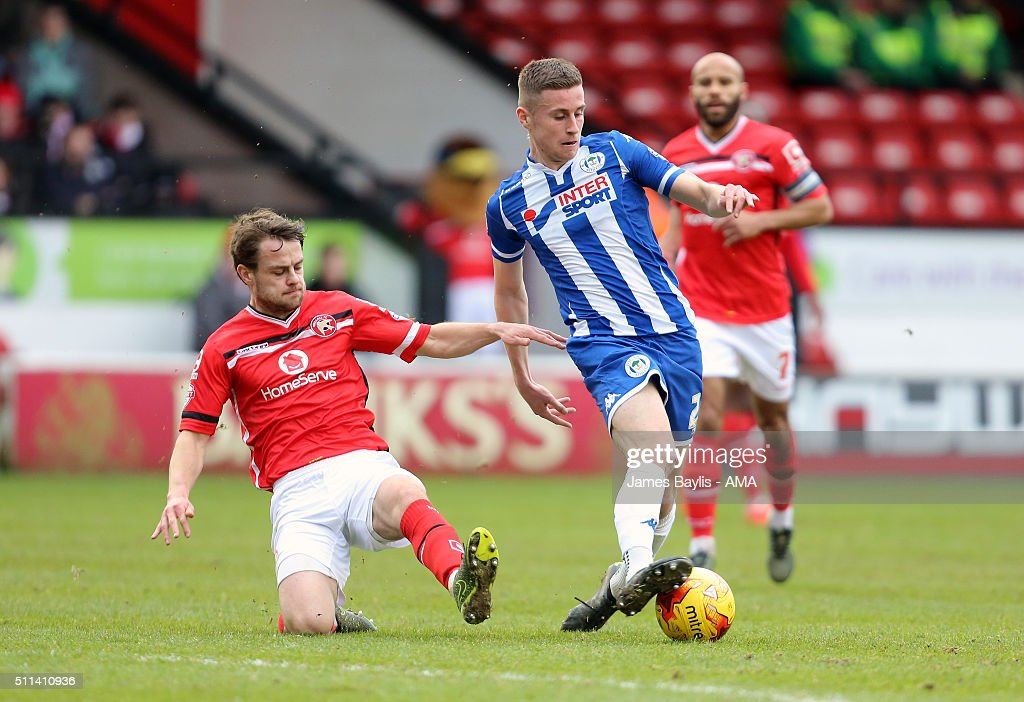 Andy Taylor of Walsall and Ryan Colclough of Wigan Athletic during the Sky Bet League One match between Walsall and Wigan Athletic at Bescot Stadium on February 20, 2016 in Walsall, England.