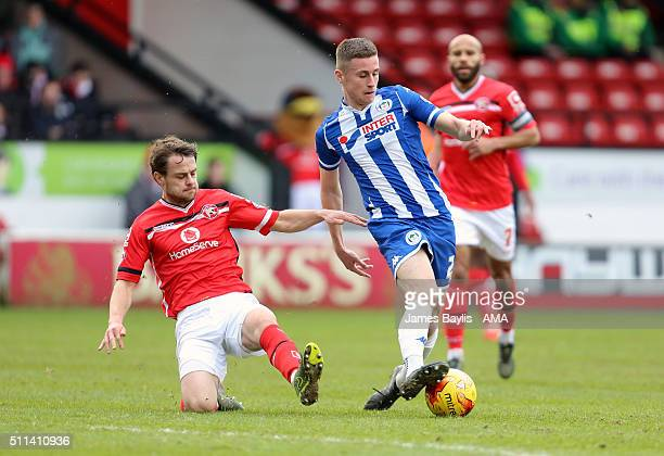 Andy Taylor of Walsall and Ryan Colclough of Wigan Athletic during the Sky Bet League One match between Walsall and Wigan Athletic at Bescot Stadium...