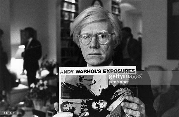 Andy Warhol American pop artist and filmmaker holding an example of one of his posters Original Publication People Disc HM0195