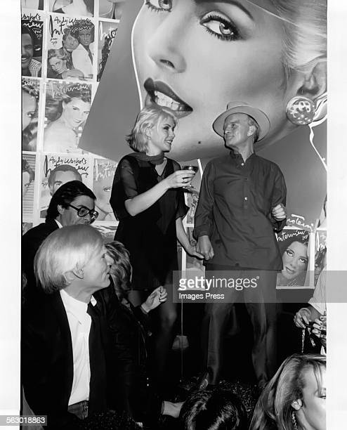 Andy Warhol Bob Colacello Debbie Harry and Truman Capote at the Interview Party at Studio 54 circa 1979 in New York City