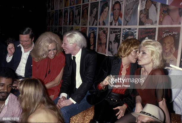 Andy Warhol holds court with Lorna Luft and Debbie Harry at the Interview Party at Studio 54 circa 1979 in New York City