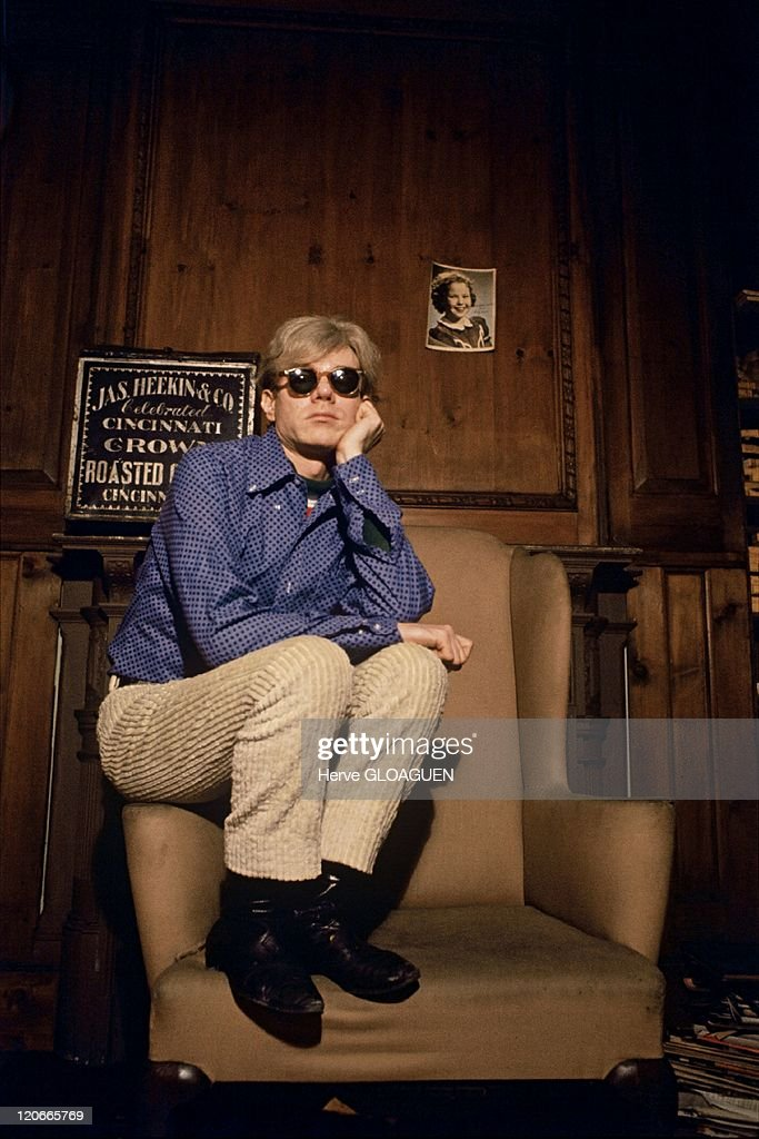 <a gi-track='captionPersonalityLinkClicked' href=/galleries/search?phrase=Andy+Warhol&family=editorial&specificpeople=123830 ng-click='$event.stopPropagation()'>Andy Warhol</a> in New York, United States in 1966 - <a gi-track='captionPersonalityLinkClicked' href=/galleries/search?phrase=Andy+Warhol&family=editorial&specificpeople=123830 ng-click='$event.stopPropagation()'>Andy Warhol</a> in his house on Lexington avenue, on the photo wall of the actress Shirley Temple.