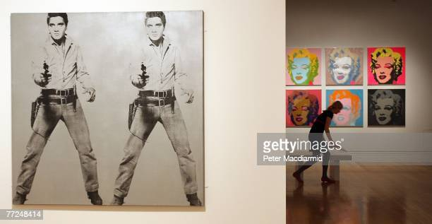 Andy Warhol's 'Double Elvis 1963' and 'Marilyn Monroe 1967' are displayed at the Pop Art Portraits exhibition at National Portrait Gallery on October...