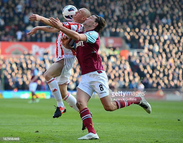 Andy Wilkinson of Stoke City battles for the ball with Andy Carroll of West Ham United during the Barclays Premier League match between Stoke City...