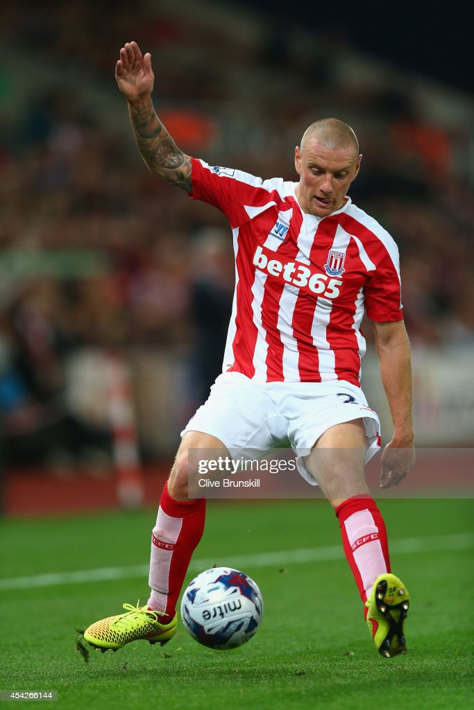Andy Wilkinson of Stoke City in action during the Capital One Cup Second Round match between Stoke City and Portsmouth at Britannia Stadium on August 27, 2014 in Stoke on Trent, England.