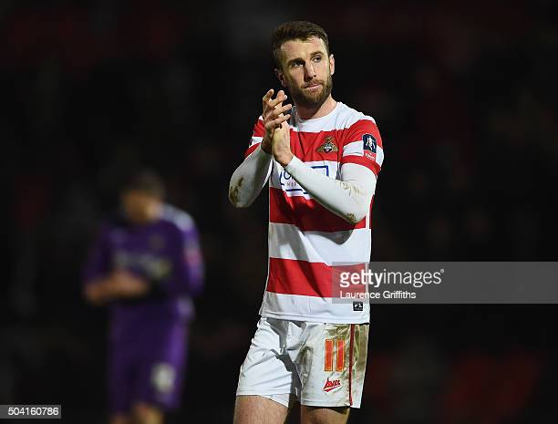 Andy Williams of Doncaster Rovers applauds fans after the Emirates FA Cup Third Round match between Doncaster Rovers and Stoke City at Keepmoat...
