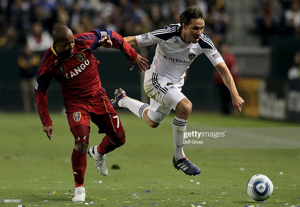 Andy Williams #77 of Real Salt Lake and Todd Dunivant #2 of the Los Angeles Galaxy battle for the ball in the second half at the Home Depot Center on April 17, 2010 in Carson, California. The Galaxy defeated Real Salt Lake 2-1.