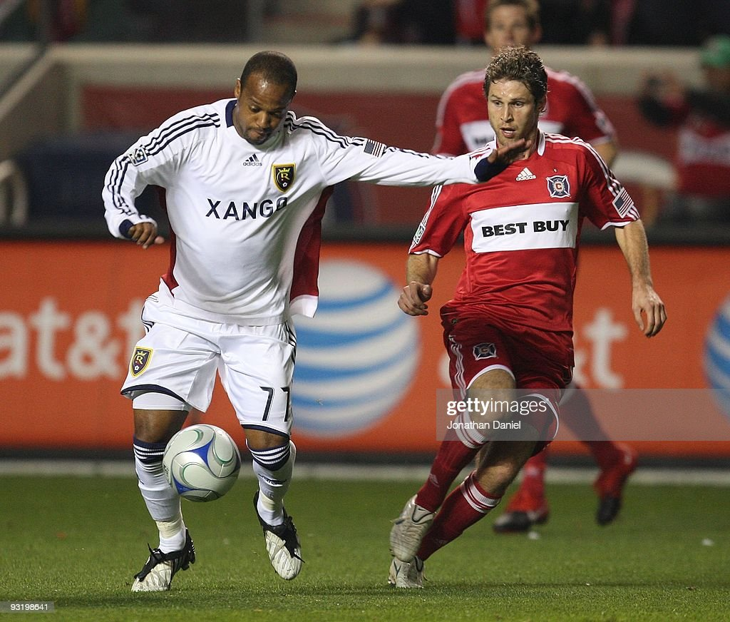 Andy Williams #77 of Real Salt Lake prepares to pass the ball as Logan Pause #7 of the Chicago Fire closes in during the MLS Eastern Conference Championship at Toyota Park on November 14, 2009 in Bridgeview, Illinois. Real Salt Lake defeated the Fire 0-0 (5-4) in a shoot-out.