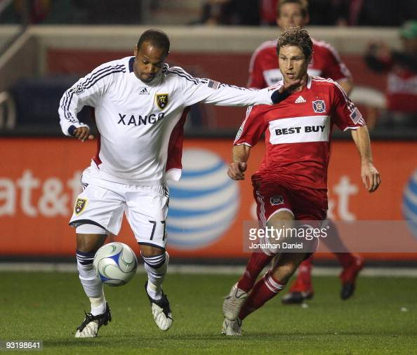 Andy Williams of Real Salt Lake prepares to pass the ball as Logan Pause of the Chicago Fire closes in during the MLS Eastern Conference Championship...