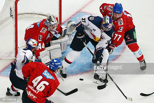 Andy Wozniewski of Muenchen is challenged by Nikolai Goc of Mannheim during the DEL match between Adler Mannheim and EHC Red Bull Muenchen at SAP...