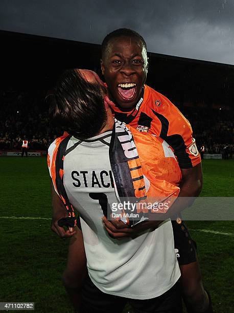 Andy Yiadom and Graham Stack of Barnet celebrate their team winning promotion during the Vanarama Football Conference League match between Barnet and...