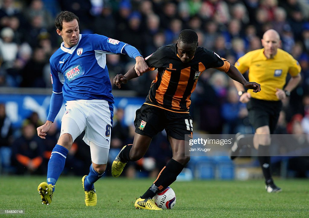 Andy Yiadom of Barnet FC battles with Sam Togwell of Chesterfield during the npower League Two match between Chesterfield and Barnet at Proact Stadium on October 27, 2012 in Chesterfield, England.